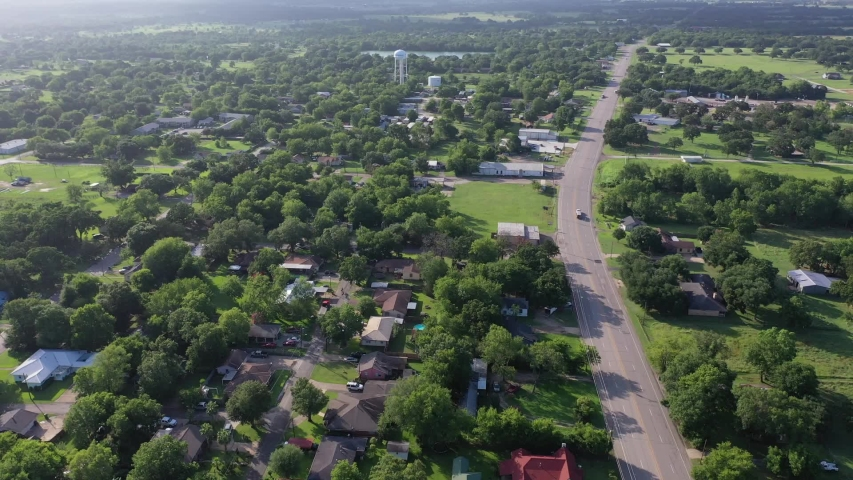 Flying over residential area toward a water tower, Madisonville, Texas, USA