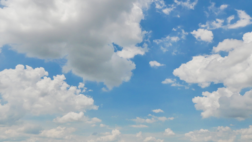 Timelapse of Clouds and Blue Sky. Puffy fluffy white clouds. Cumulus cloud scape timelapse. Summer blue sky time lapse Royalty-Free Stock Footage #1054316285