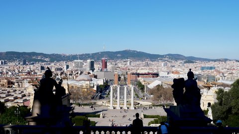 Panoramic view of landmark square and the four columns on a sunny day in Barcelona, Spain