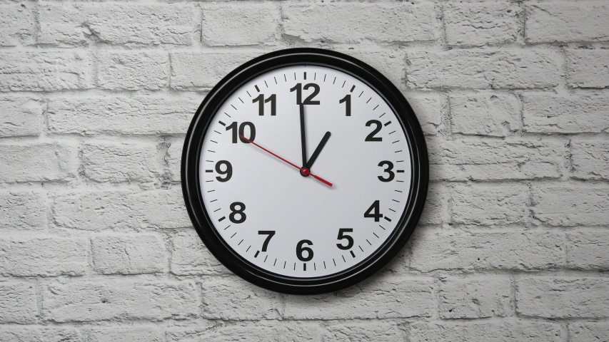 The Time Is 1.00 AM Or PM On A Black Wall Clock With A Red Second Hand On A White Brick Wall | Shutterstock HD Video #1054323377