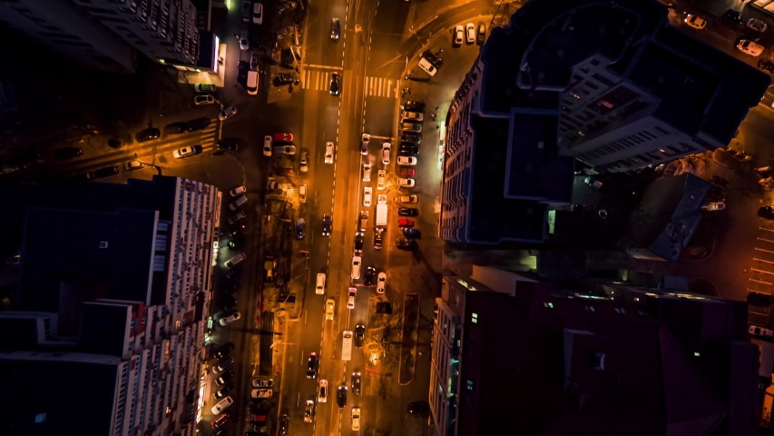 Aerial drone vertical view of Bucharest city centre square traffic hour at night | Shutterstock HD Video #1054325000