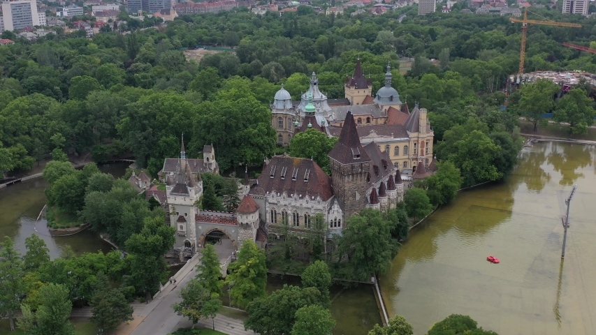 Beautiful views of Vajdahunyad Castle. In front of it is the city park, the boating lake. Tourist attraction without tourists in the coronavirus period. Drone recording. | Shutterstock HD Video #1054325423