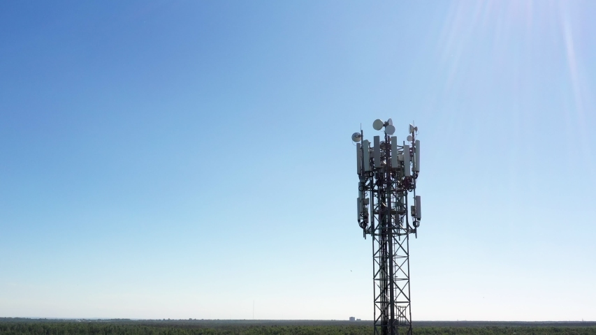 Cellular GSM tower with 3g, 5g transmitter. Communication antenna. Future technology. Aerial view from drone Royalty-Free Stock Footage #1054332215