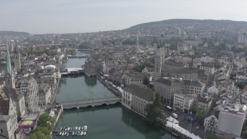 D-Log. Zurich, Switzerland. Panorama of the city from the air. Limmat River Flow Point, Kvaybrucke Bridge, Sechselautenplatz Square, Aerial View, Point of interest