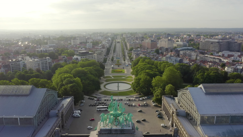 Dolly zoom. Brussels, Belgium. Park of the Fiftieth Anniversary. Park Senkantoner. The Arc de Triomphe of Brussels (Brussels Gate), Aerial View, Departure of the camera Royalty-Free Stock Footage #1054334960