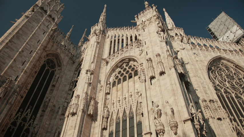 The World-Famous Duomo In Milan, Italy, Lombardy. Close-Up View From Below. A Magnificent Religious Catholic Building. Bright Sunny Day. | Shutterstock HD Video #1054338845