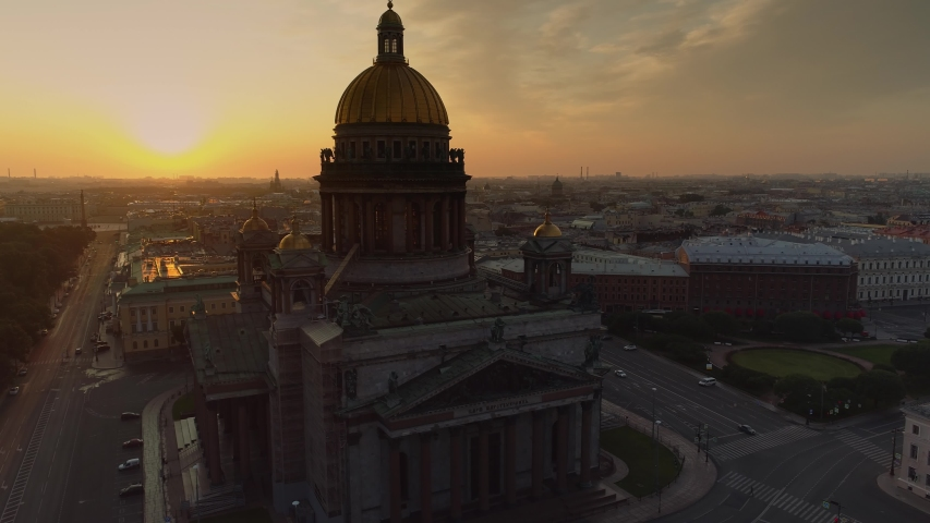 Beautiful St. Isaac's Cathedral Petersburg. Sunrise sun dramatic central cityscape. Historical streets roofs. Golden dark dome cross. Best landmark. Russia nobody. Skyline open space. Aerial forward | Shutterstock HD Video #1054339382