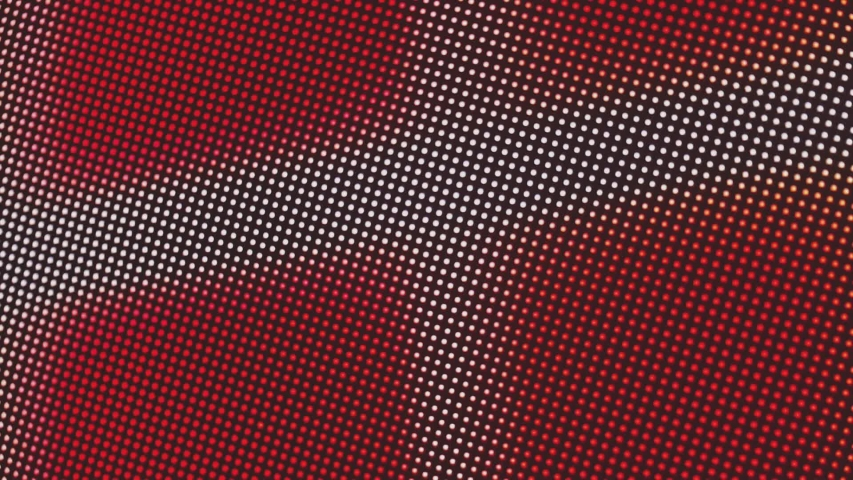 Close-up of the LCD screen pixels. Abstract background. Close the color-coded LED display. RGB pixels on a TV while a movie is being shown. Red, blue and green subpixels create an image on the screen. | Shutterstock HD Video #1054348820