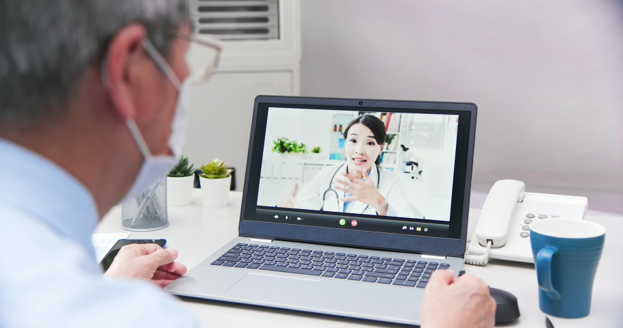 Telemedicine concept - asian female doctor explain about disease to the male elder patient by video chat | Shutterstock HD Video #1054352771