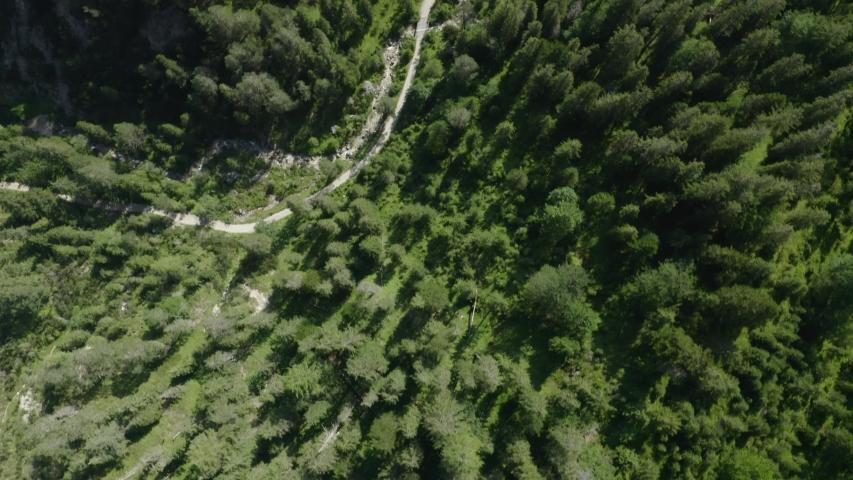Beautiful Ariel birds eye shot flying through a hiking trail within the Austrian Alps in tyrol
