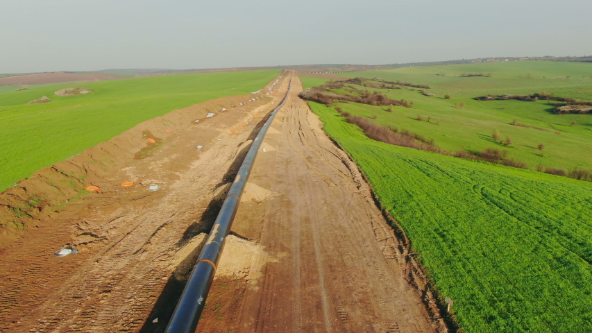 Drone flight Above Gas and Oil Pipeline. Pipes welded together, are laid on top of supportive sandbags beside the trench line. Turkish Balkanian Stream to Europe with Russian gas.