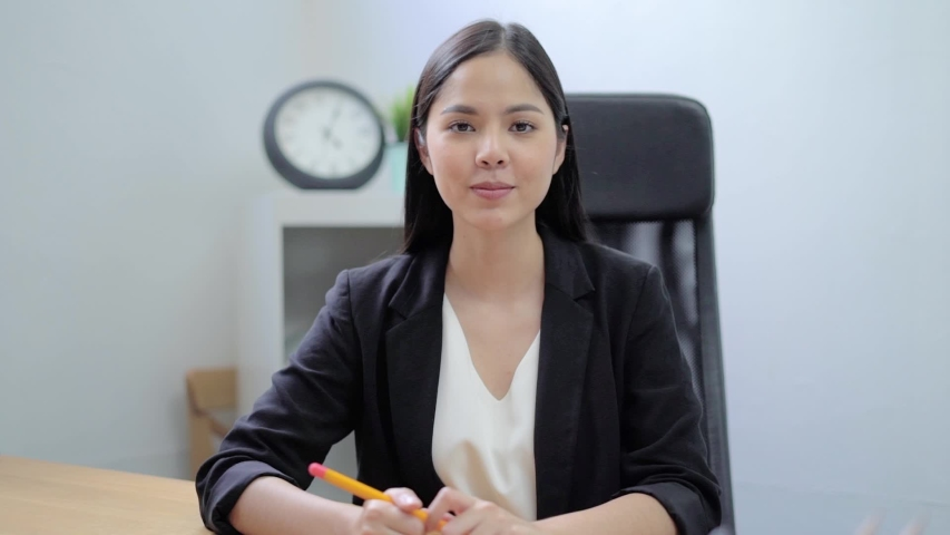 Smiling young asian woman blogger vlogger influencer sit at home speaking looking at camera talking make video conference call record lifestyle blog vlog doing video chat at home concept, webcam view. Royalty-Free Stock Footage #1054357325