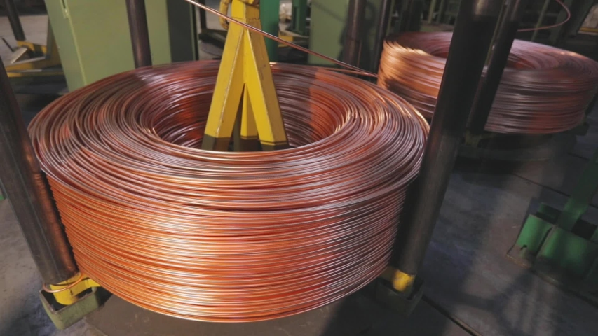 Modern cable manufacturing, cable factory. Copper cable production process in a modern factory   Shutterstock HD Video #1054359914