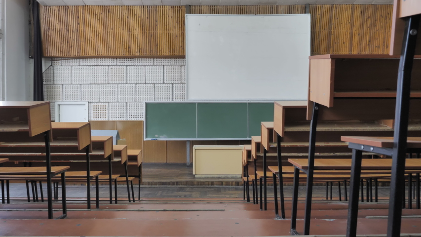 Empty Auditorium With Wooden Desks And Chairs  Royalty-Free Stock Footage #1054360196