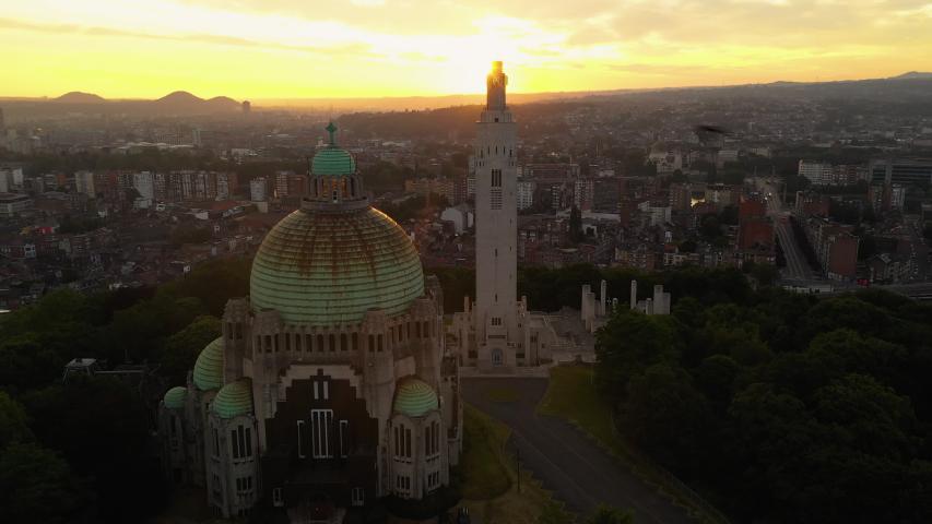 Drone footage of Église du Sacré-Coeur de Cointe church before sunrise | Shutterstock HD Video #1054361423