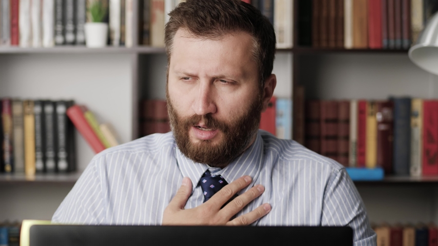 Trouble breathing, chest pain. Close-up of working bearded man, he has difficulty breathing or chest pain, touches his chest with hand. Heart attack, thoracic osteochondrosis, panic attack concept | Shutterstock HD Video #1054361846