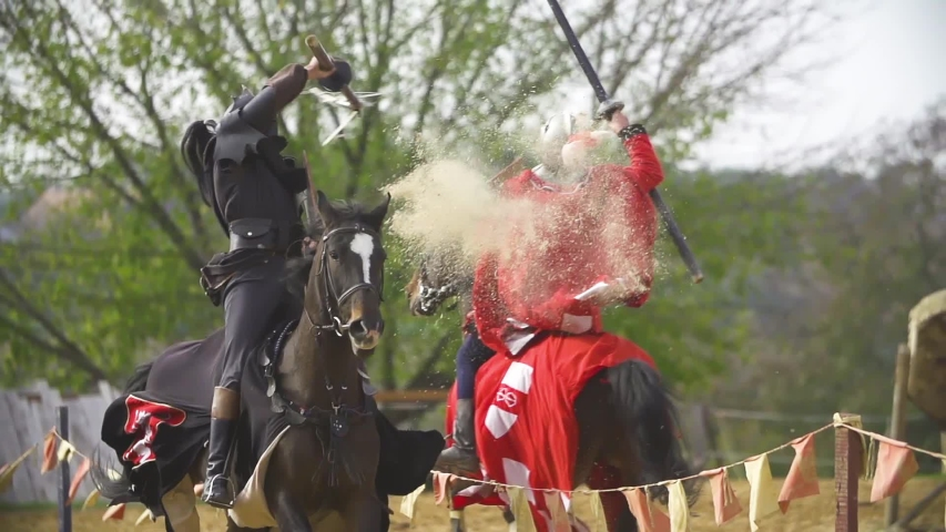 Vintage armored knights fighting demonstration. Slow motion stock footage. | Shutterstock HD Video #1054363607
