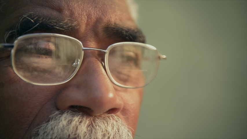 Real old black people, face expression and emotions, portrait of authentic sad elderly african american man with glasses looking away