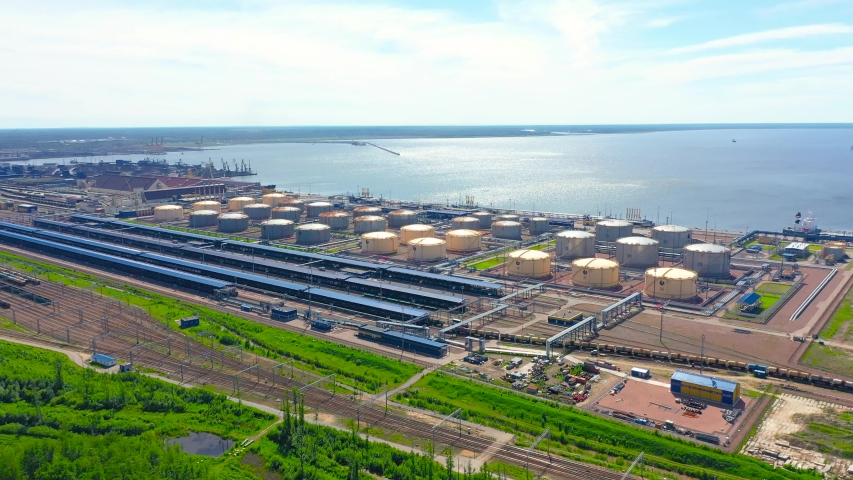 Panoramic view of the huge transport cargo hub of the seaport on the coast of the sea. Tanks for the storage of flammable liquids