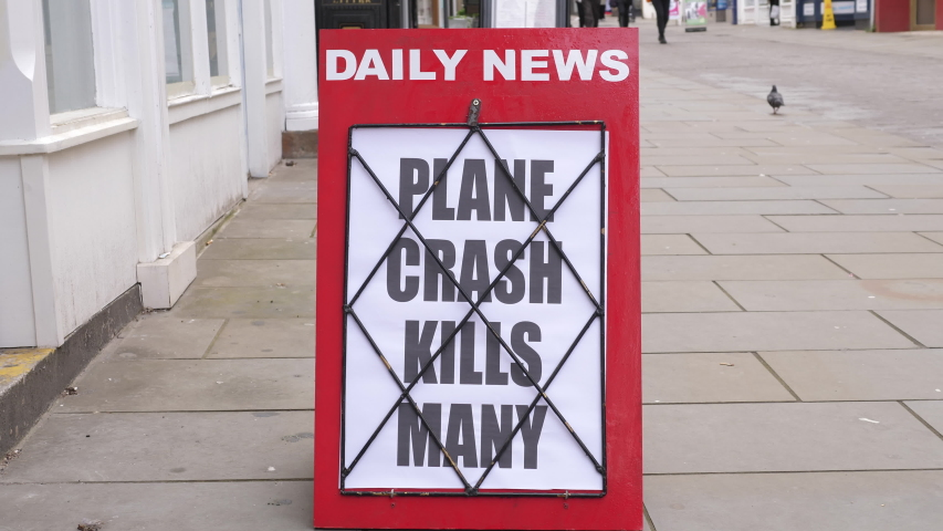 4K: Newspaper Headline Board about a Plane or Airplane Crash - News stand. Stock Video Clip Footage | Shutterstock HD Video #1054369103