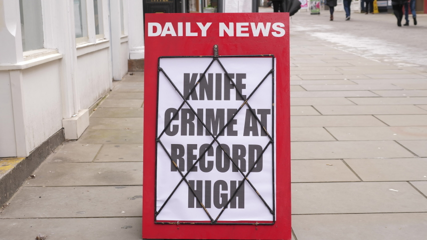 4K: Newspaper Headline Board about Knife Crime on the increase - News stand. Stock Video Clip Footage | Shutterstock HD Video #1054371011