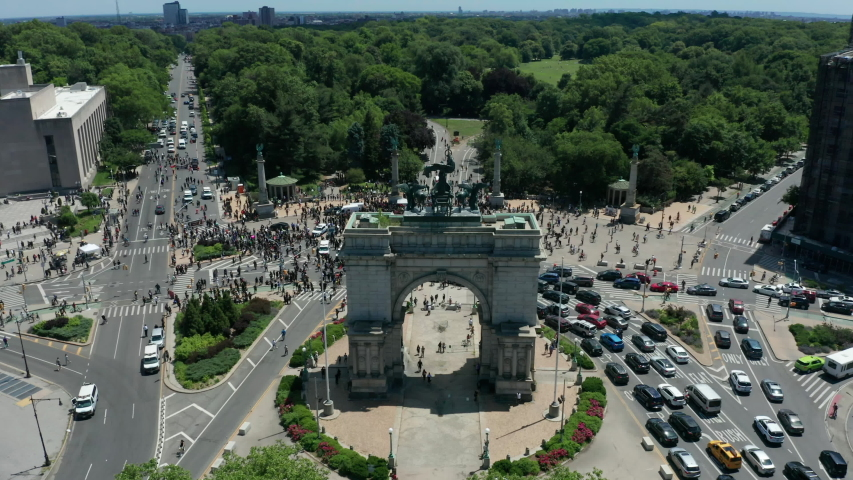 Alt flying over arch towards revealing huge BLM protest at Grand Army Plaza in Brooklyn | Shutterstock HD Video #1054378796