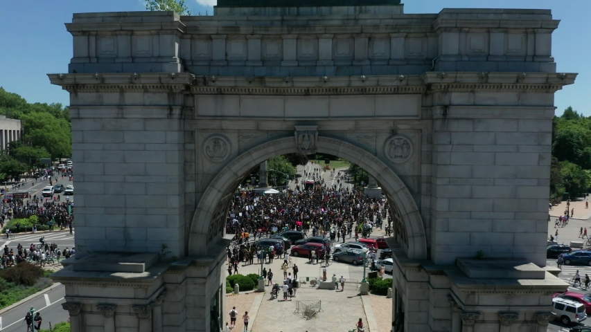 Rising over arch reveal of huge BLM protest in Grand Army Plaza Brooklyn | Shutterstock HD Video #1054378799