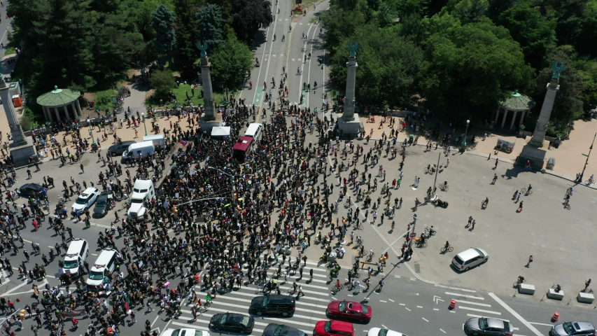 Aerial view of huge BLM protest in Grand Army Plaza Bkln, flying bkwd over arch | Shutterstock HD Video #1054378805