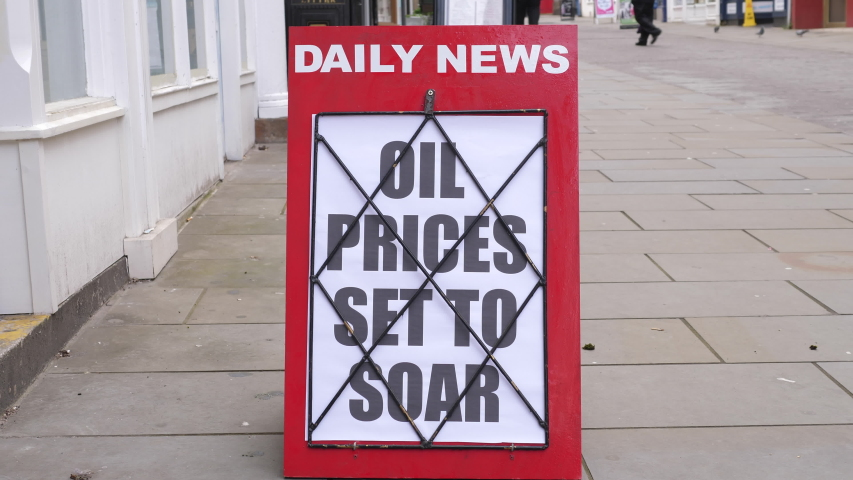 4K: Newspaper Headline Board about Oil Prices soaring and going up - News stand. Stock Video Clip Footage | Shutterstock HD Video #1054380131
