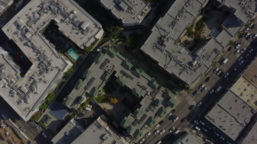 AERIAL: Birds Eye View over Streets of Downtown Los Angeles, california with cars,Traffic and rooftops,Pools, Daylight  | Shutterstock HD Video #1054381505