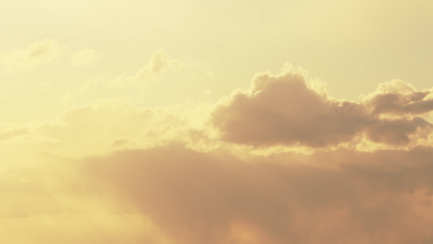 Sun Rays Shining Through Cloudy Sky With Fluffy Clouds. Sunset Sky During Rain   Shutterstock HD Video #1054381520