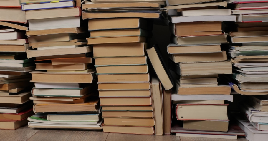 Many books in a pile, panning background | Shutterstock HD Video #1054382879