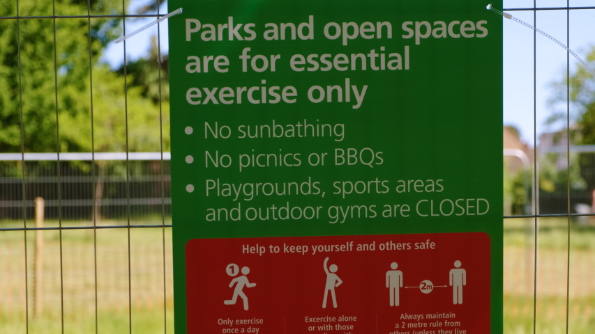 THE NEW NORMAL - Social Distancing measures are implemented at a recreational park in London, England, UK Royalty-Free Stock Footage #1054387196