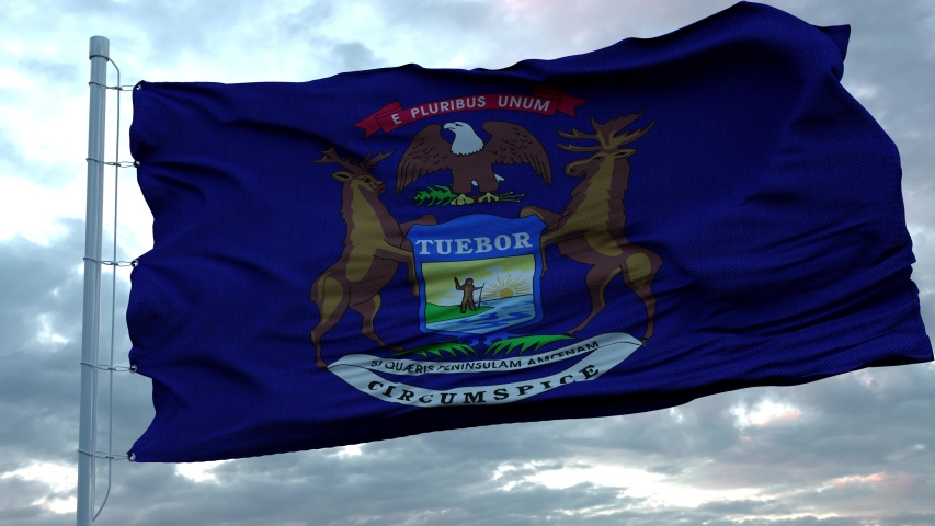Flag of Michigan waving in the wind against deep beautiful clouds sky