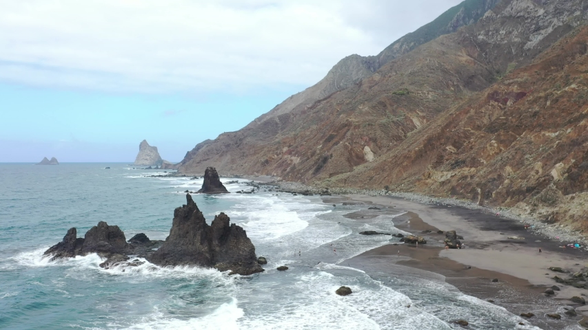 Tenerife, the wild Benijo beach with black volcanic sand. Atlantic ocean
