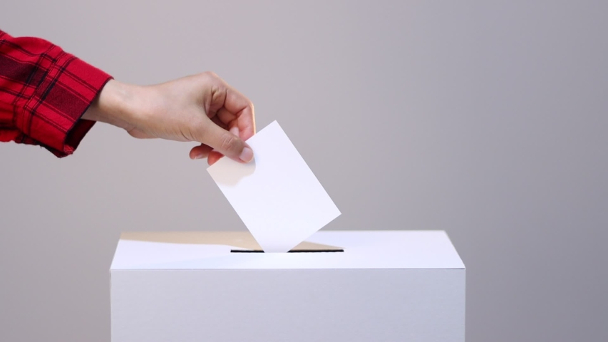 People putting paper in ballot box Royalty-Free Stock Footage #1054390943