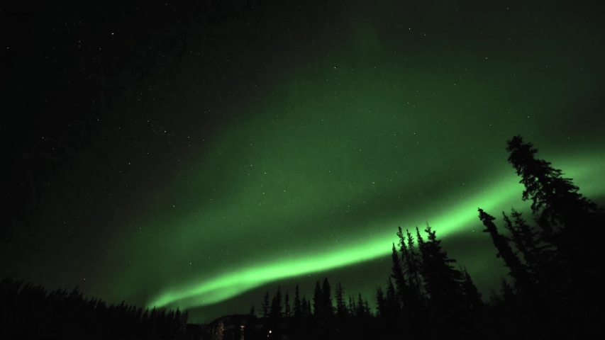 Magnificent aurora borealis show seen in Yukon Territory, northern Canada. Northern Lights in the winter from the north.  Royalty-Free Stock Footage #1054391360