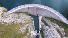 Aerial drone footage top view Water dam and reservoir lake, generating hydro electricity power renewable energy and sustainable development. . High quality 4k footage