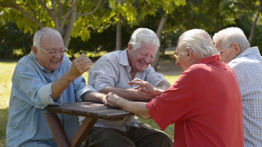 Active retired senior people and leisure, authentic old friends and free time, elderly men having fun, talking, smiling outdoors in urban city park Royalty-Free Stock Footage #1054404107