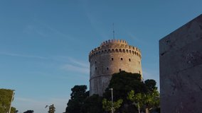 4K reveal clip of the White Tower monument in Thessaloniki, Greece, On a clear morning