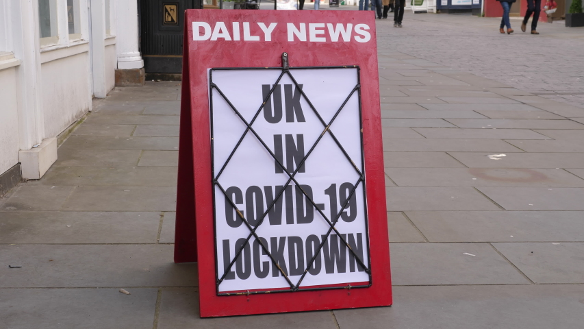 4K: Newspaper Headline Board about The UK being in Coronavirus Covid-19 Lockdown - News stand. Stock Video Clip Footage | Shutterstock HD Video #1054404518