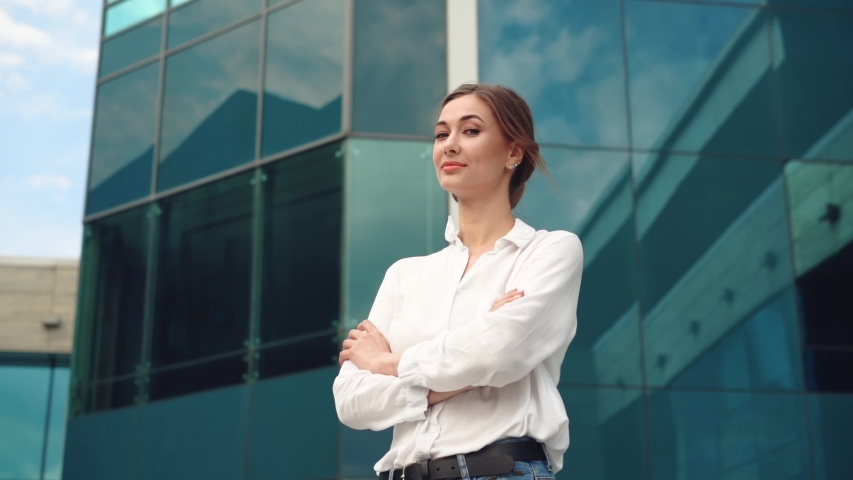 Businesswoman successful woman business person standing outdoor corporate building exterior Pensive elegance caucasian confidence professional business woman middle age female leader | Shutterstock HD Video #1054406051