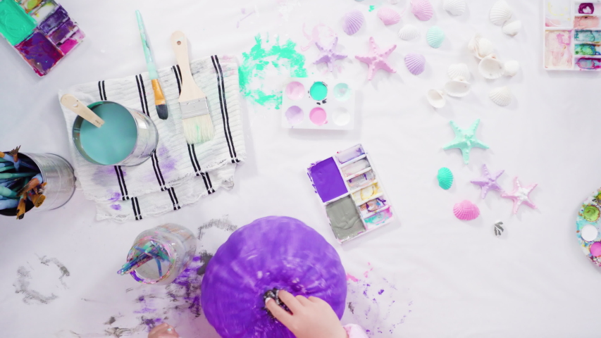 Flat lay. Step by step. Painting craft pumpkin with acrylic paint to create decorated mermaid Halloween pumpkin. | Shutterstock HD Video #1054409672