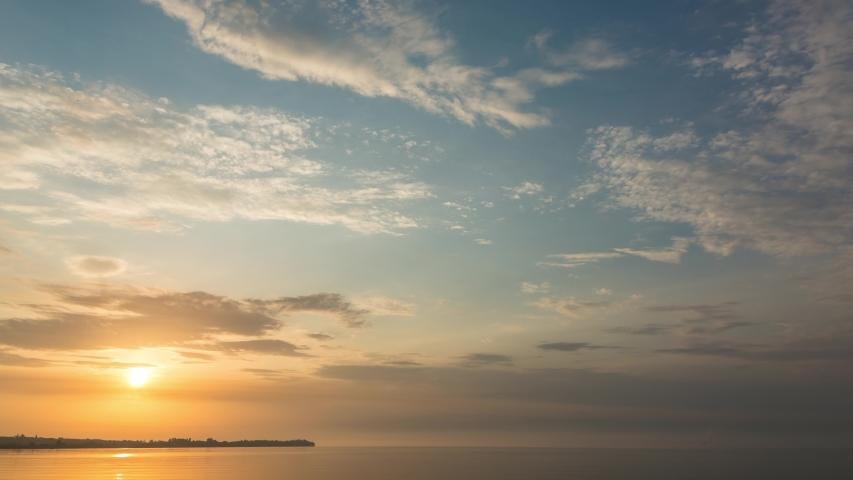 Sunrise over the river near the shore, timelapse, 4k