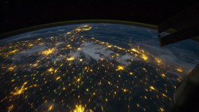 ISS Time-lapse Video of Earth seen from the International Space Station with dark sky and city lights at night overNorth South USA, Time Lapse 4K. Images courtesy of NASA.