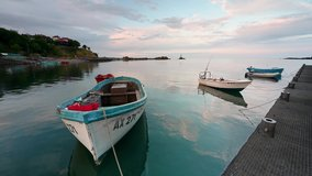 Video with with anchored boats at a small marina at sunset, Ahtopol village, Bulgaria