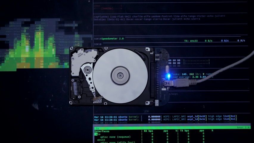 Work of hacked hard drive inside. Hacker breaks sensitive data from a hard drive. Against the background, lines of code and data flash. Cybersecurity. Government secret data hacking technology HDD Royalty-Free Stock Footage #1054414427
