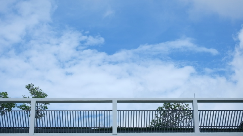4k time lapse beautiful blue sky with clouds background.Sky clouds.Sky with clouds weather nature cloud blue.Blue sky with clouds | Shutterstock HD Video #1054414997