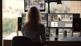 Woman Video Editor On TV Station Office.Female Video Editor Work With Footage In Post Production Company.Using Movie Editing Software.Videographer Working On Computer News Media On Broadcasting Studio