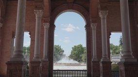 Central fountain in Plaza de España between arches